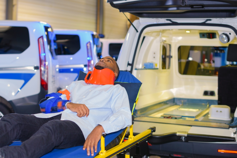 Man on ambulance stretcher - Air Ambulance | Global Medical Response | International Emergency Medical Services| Non-Emergency Ambulance Transportation | EMS Transportation